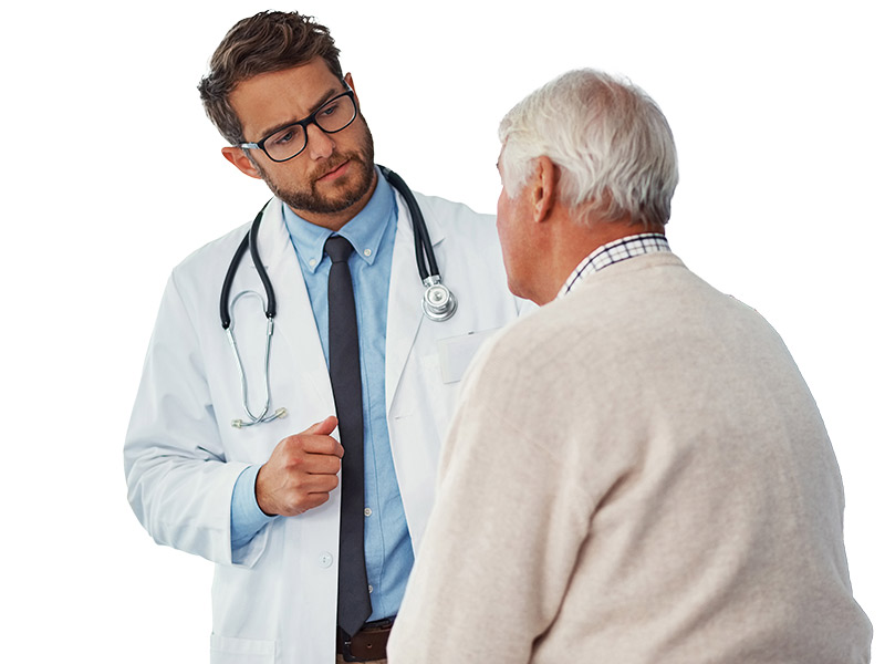 Physician listening to older male patient