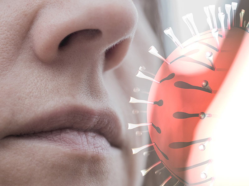The face-of-a-woman-with-the-COVID-19-virus-near-her-nose.